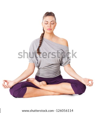 Young woman meditating in Lotus Pose. Isolated on white background - stock photo