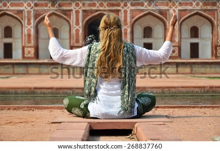 Young woman meditating in the yard of Humayun's Tomb. Delhi, India - stock photo