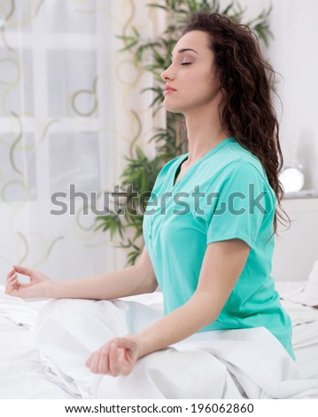 Young woman meditating with closed eyes