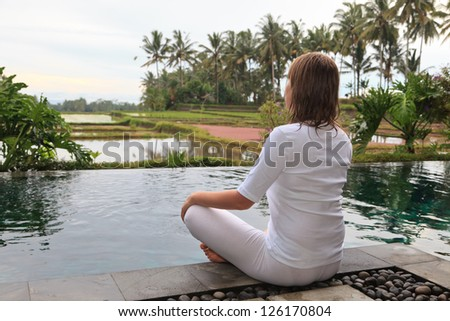 Young woman meditation outdoors - stock photo