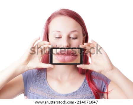 young woman messing around with camera phone taking picture of her own lips