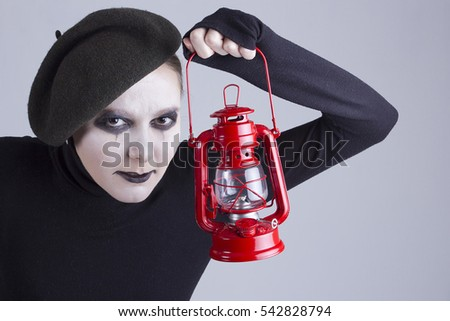 Young woman mime with red lantern