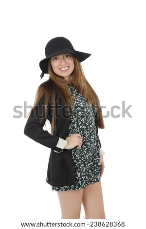 Young woman model wearing a hat and posing against a white background - stock photo