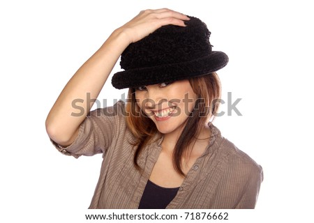 Young woman modeling her hat