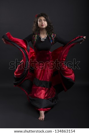 Young woman mowe forward in spanish traditional clothes