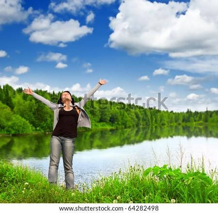 Young woman near the lake. - stock photo