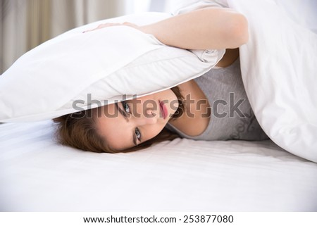Young woman not being able to sleep - stock photo