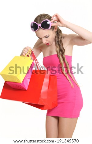 young woman of fashion with shopping, surprise stares at his shop