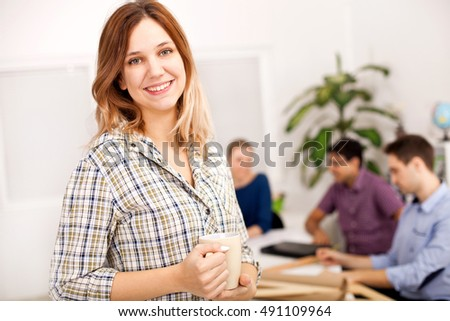 Young woman on a coffee break in the office