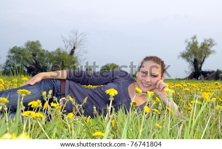 young woman on a flower meadow - stock photo