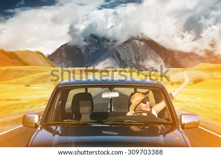 young woman on a roadtrip - stock photo