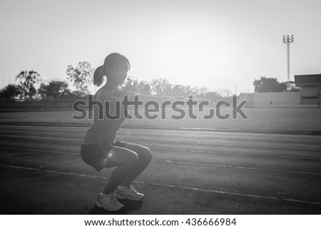 Young woman on a running track  Female jogging.  - stock photo