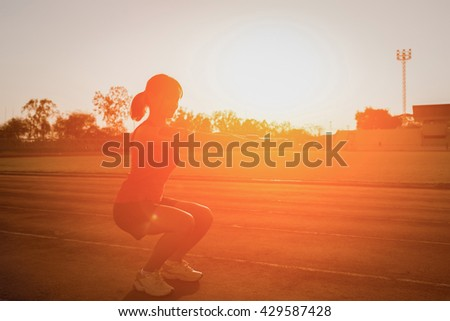 Young woman  on a running track  Female jogging. Fitness health - stock photo