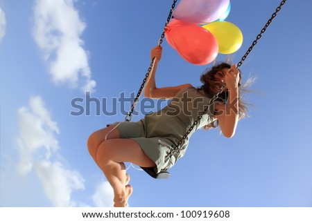 Young woman on a swing - stock photo