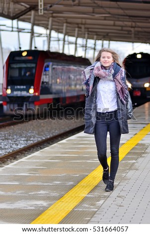 Young woman on a train station