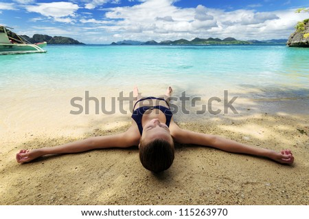 Young woman on a tropical beach.