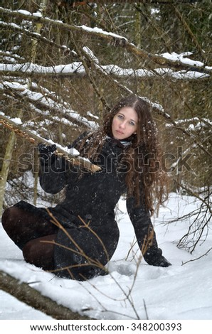 young woman on a walk in woods