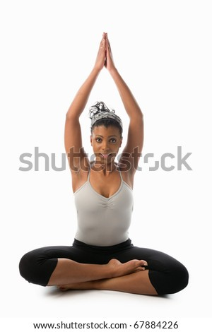 young woman on a white background doing yoga - stock photo