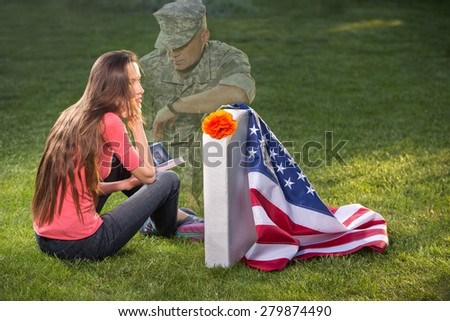 Young woman on American cemetery. Memorial Day concept - stock photo