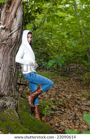 young woman on autumn forest under chestnut tree