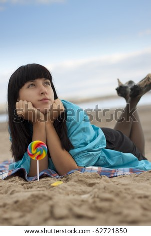 Young woman on beach in autumn.