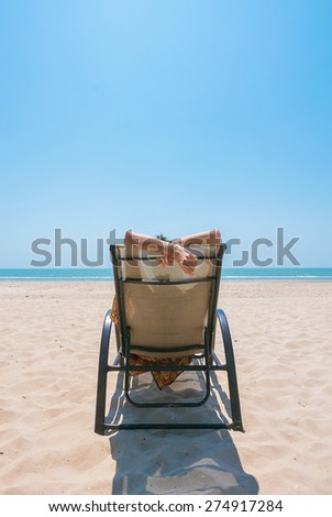 Young woman on bed deck tropical beach with blue sky