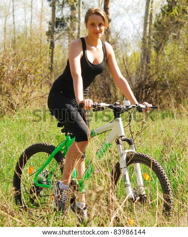 young woman on bicycle - stock photo