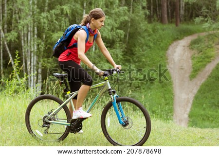 Young woman on bike outdoors