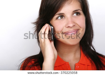 Young woman on cell phone. - stock photo