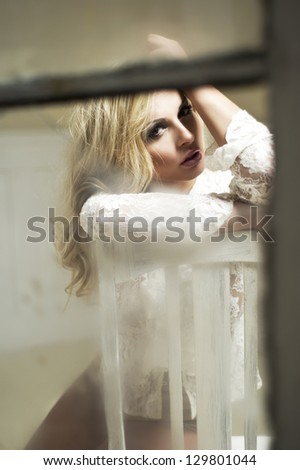 Young woman on chair. - stock photo
