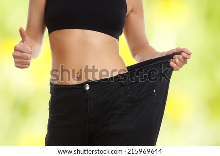 Young woman on diets thumb up - stock photo