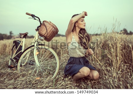 Young woman on field looking someone - stock photo