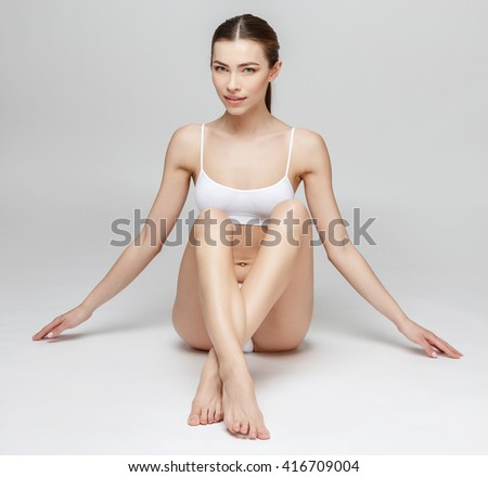 Young woman on gray background - stock photo