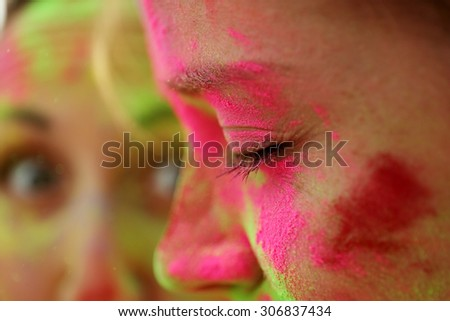 Young woman on Holi color festival in park - stock photo