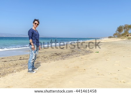 Young woman on one of the most beautiful beaches in the world in Naxos island, Cyclades, Greece.