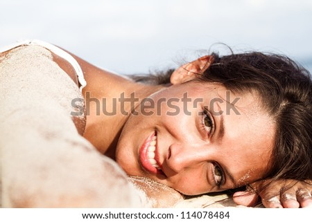 young woman on sand beach