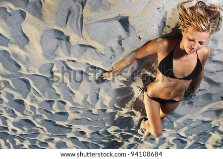 young woman on sand beach - stock photo