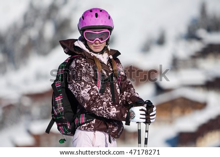 Young woman on ski resort. Winter vacation - stock photo