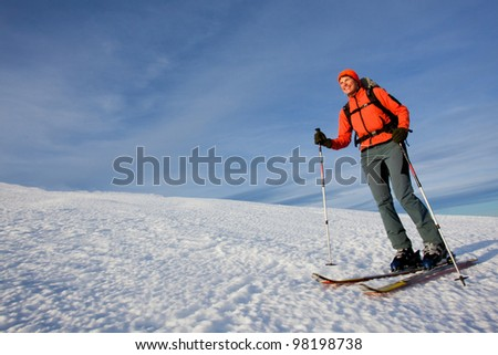 Young woman on ski with large copy space - stock photo