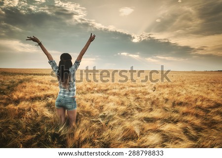 Young woman on summer field