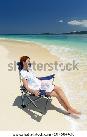 young woman on the beach enjoy sunlight