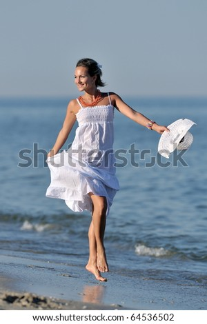 young woman on the beach in summer