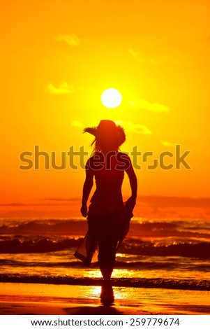 young woman on the beach in summer evening - stock photo