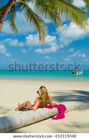 young woman on the beach near the indian ocean