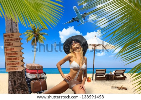 Young woman on the beach Travel concept - stock photo