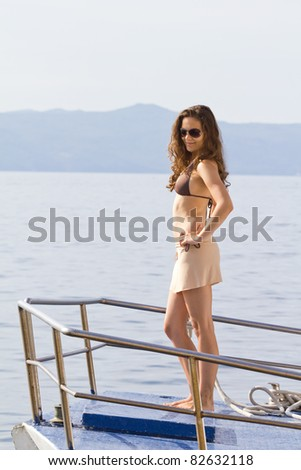 Young woman on the boat - stock photo