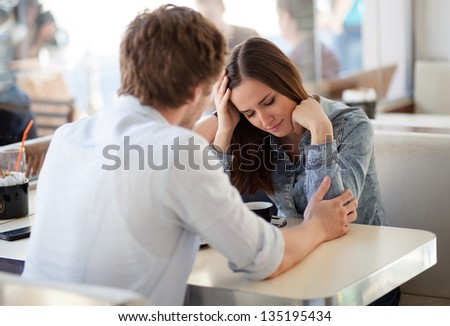 Young woman on the brink of crying. Relationship problems. - stock photo