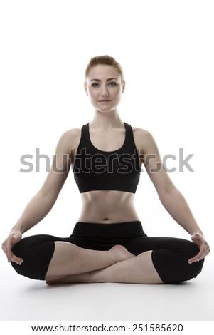 young woman on the floor doing yoga - stock photo