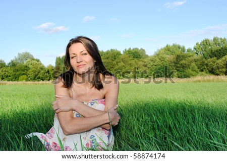 young woman  on the  green field. - stock photo