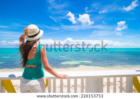 Young woman on the seashore during summer vacation